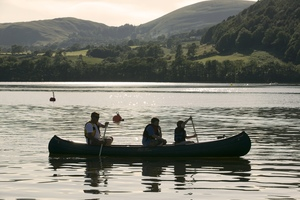 Family canoeing on Ullswater (c) Tony West and Cumbria Tourism