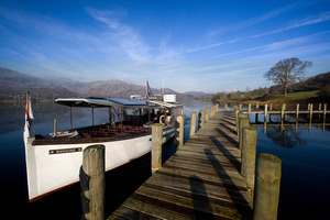 """Ruskin"" landing at the Brantwood jetty with the Coniston fells behind (c) Ben Barden and Cumbria Tourism"